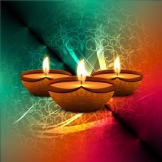 排灯节在彩色背景三根蜡烛